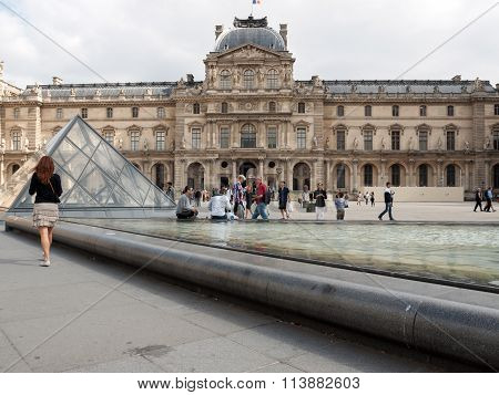 PARIS, FRANCE - SEPTEMBER 11, 2014:Paris - The Louvre . Louvre is one of the biggest Museum in the world receiving more than 8 million visitors each year.