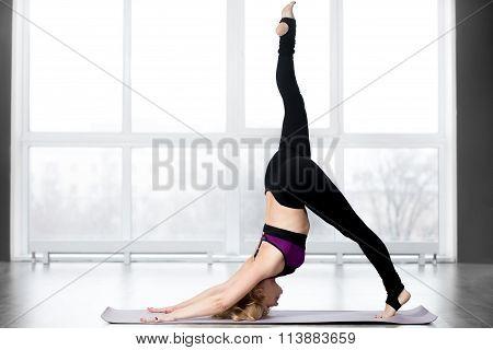 Senior Woman Doing One-legged Downward-facing Dog Pose