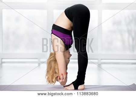 Senior Woman Doing Dangling Yoga Pose