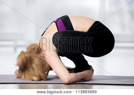Senior Woman Doing Malasana Yoga Pose