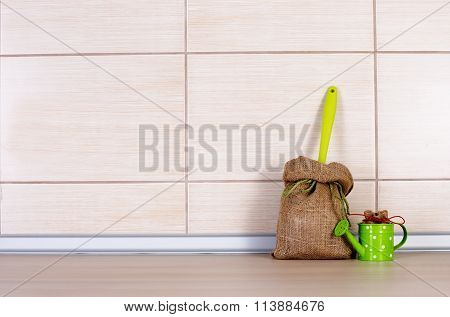 Sack And Water Pot On Kitchen Countertop