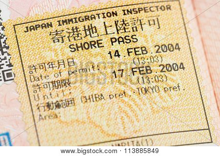 Passport page with the Japanese shore pass immigration control stamp at the Narita airport.