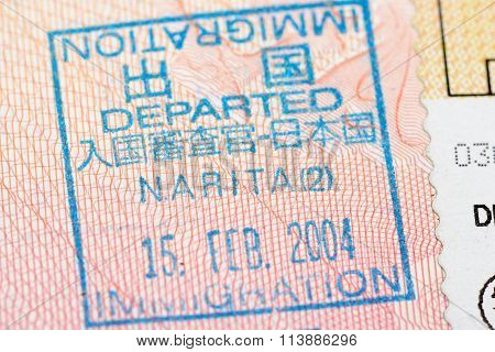 Passport page with the Japan departure immigration control stamp at the Narita airport.