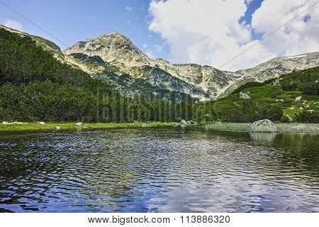 Amazing view of Muratov peak and river in Pirin Mountain