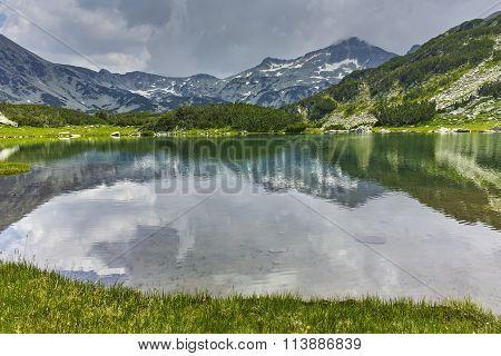 Reflection of Banderishki Chukar Peak in Muratovo lake, Pirin Mountain