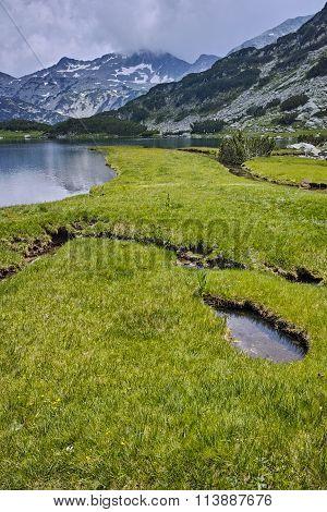 Amazing green meadows and Muratovo lake, Pirin Mountain