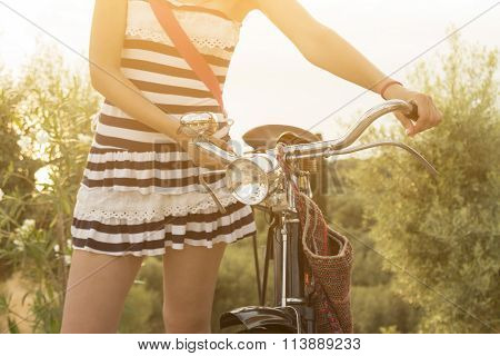 Female hands on bicycle handlebar