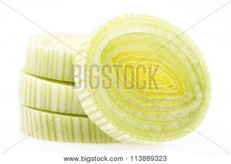 Some Slices Of Green Leek Isolated On White Background