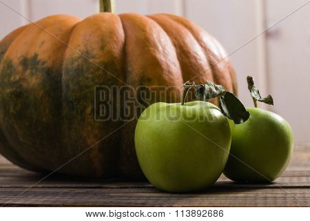 Closeup Photo Of Pumpkin And Two Apples