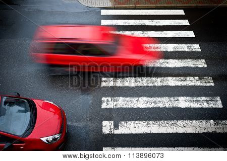 Two Red Cars On The Pedestrian Crossing