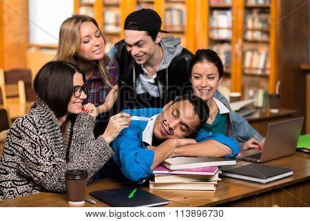 Students joking at groupmate