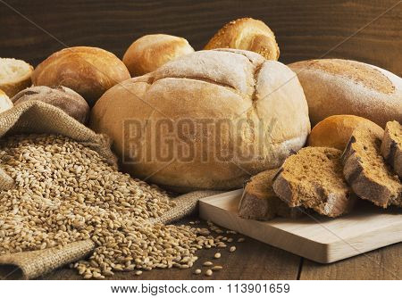Bread And Grains Scattered On The Wooden Table