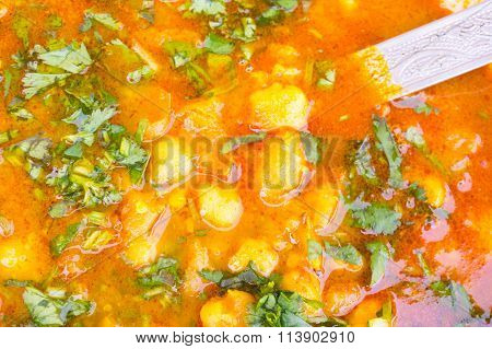 Indian potato gravy dish garnished with coriander