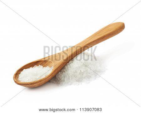 Wooden spoon over the salt
