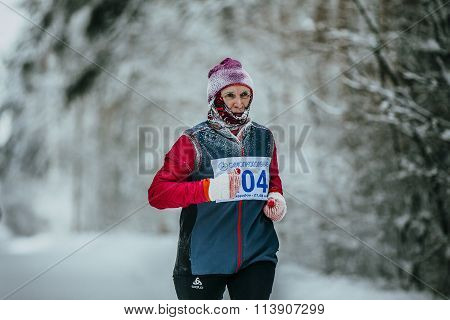 closeup male runner average years of running in winter woods