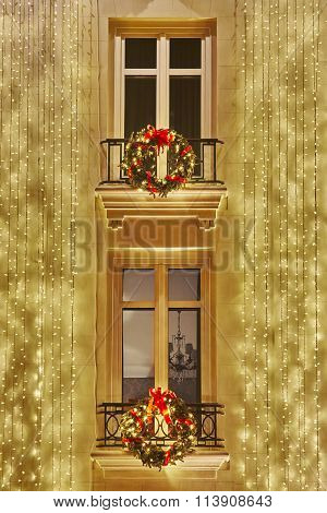 Christmas Decoration Lights Over A Classic Building Facade