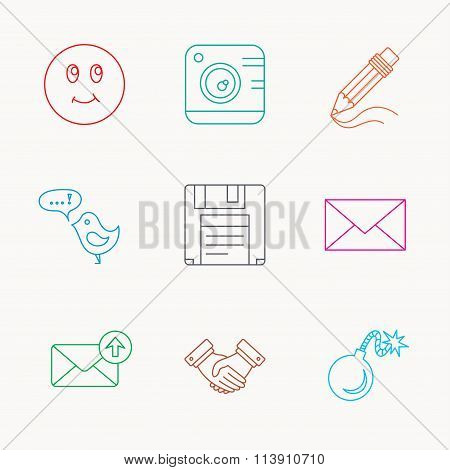 Photo camera, pencil and handshake icons.