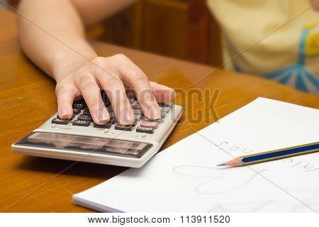 Hand Calculates Number With Calculator Background