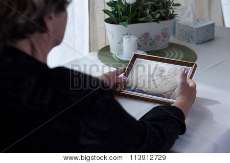 Lonely Aged Female Holding Photo