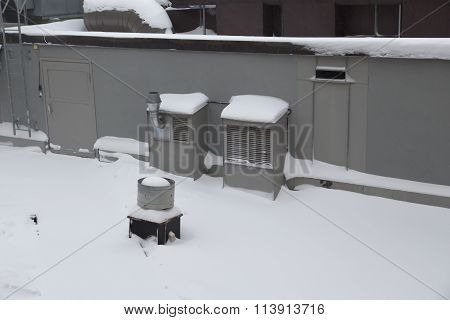 Ventilation on a snowy roof