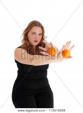 Woman Holding Two Oranges.