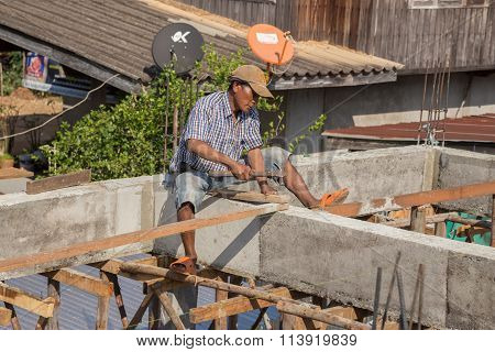 Unidentiflied Worker Installing Wood During Construction