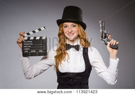 Pretty girl wearing retro hat  and holding clapperboard isolated