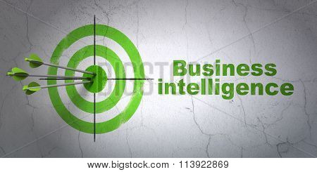 Business concept: target and Business Intelligence on wall background