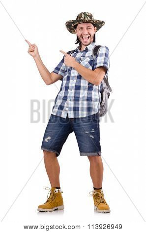 Young traveller with backpack pointing isolated on white