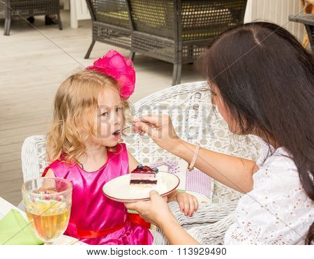 Little Adorable Girl Celebrating 3 Years Birthday And Eat Cake. Kid  Wearing Flower Hairband On Part