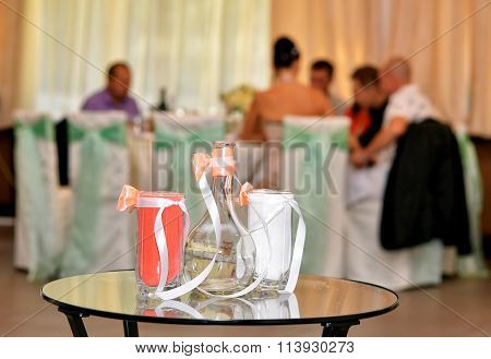 The Carafe And Two Glasses With Colored Sand