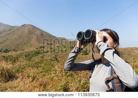 Woman use of the binocular