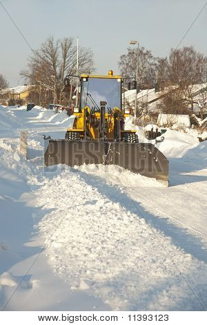 Tractor Shoveling Snow