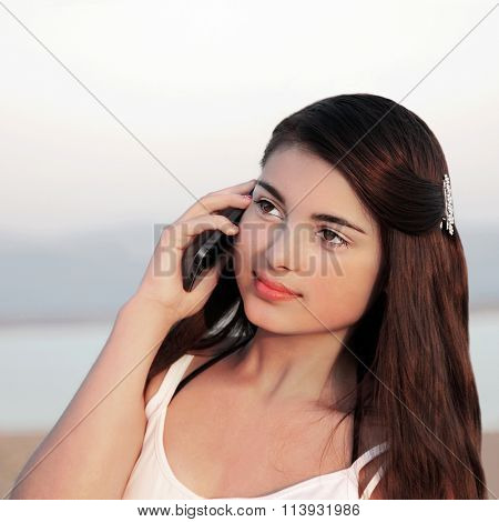 Young beautiful caucasian teenage girl on her cell phone.