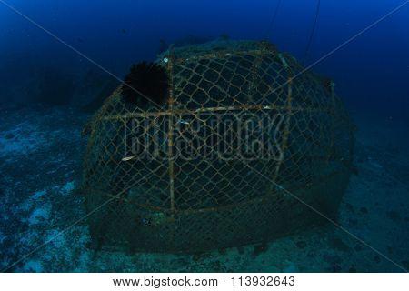 Environmental damage illegal fish net trap in ocean