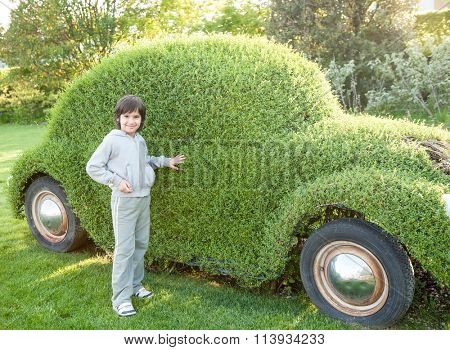 Kid with green car