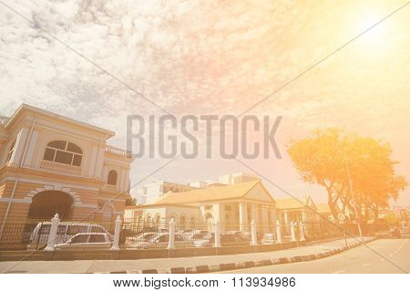 Modern city street and exotic Western-style buildings with the blue sky, Malaysia, Asia.