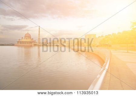 Cityscape with mosque near river in Putrajaya, Malaysia, Asia.
