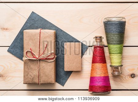 Gift box with blank tag and cute bottles.