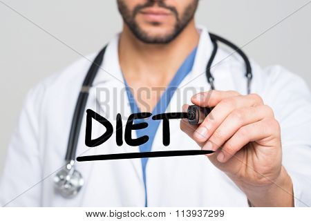 Doctor writing the word Diet