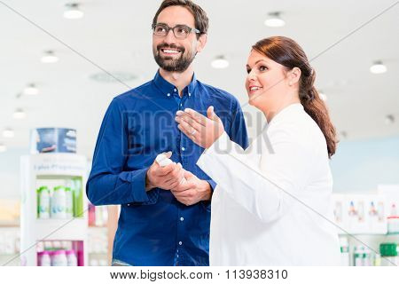Man in drug store with sales lady shopping