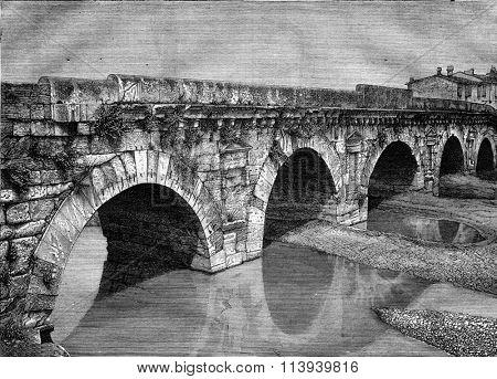 The Bridge of Augustus in Rimini, vintage engraved illustration. Magasin Pittoresque 1876.