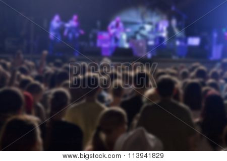 Defocused crowd and performers on music festival