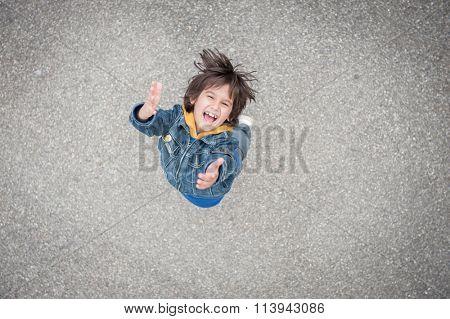 Jumping running kid on the street