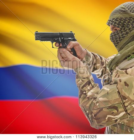 Male With Gun In Hand And Canadian Province Flag On Background - Colombia