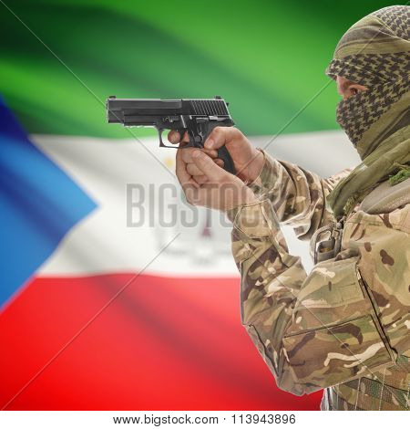 Male In With Gun In Hand And National Flag On Background - Equatorial Guinea