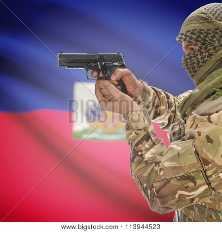 Male In With Gun In Hand And National Flag On Background - Haiti