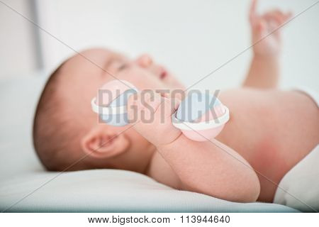 Baby with rattle toy