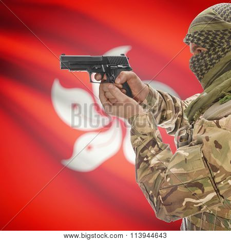 Male In With Gun In Hand And National Flag On Background - Hong Kong