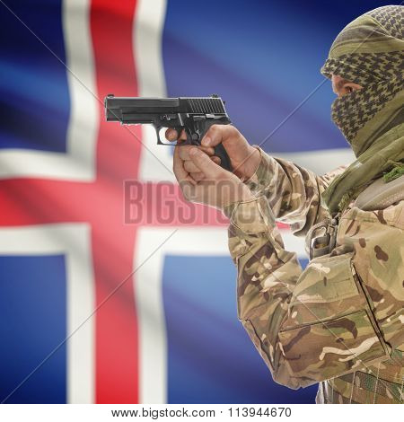 Male In With Gun In Hand And National Flag On Background - Iceland